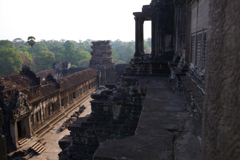 The side of temple buildings and a forest, Angkor Wat.