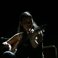 Gabriela Quintero playing guitar